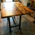 Drop-leaf Barnwood Table with Heavy-Duty Black Pipe Legs.