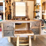 Make-up vanity with matching stool. Wyoming barnwood throughout. Four drawers; swivel mirror.
