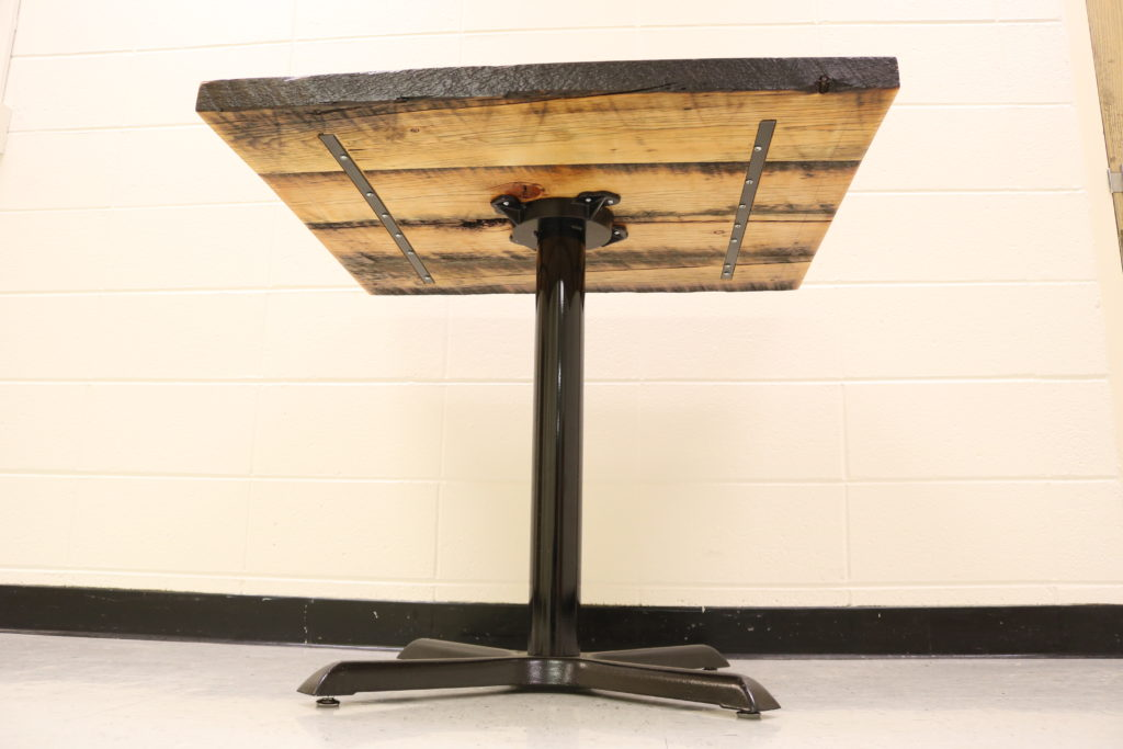 Barnwood cafe table, view of the underside looking up from the floor.