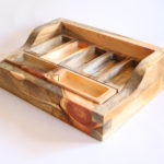 Custom designed for use as an organizer and display case. The individual compartments are all interchangeable and can be arranged in countless ways. All reclaimed Wyoming lumber. Hand-cut dovetail joinery.
