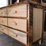 6-drawer dresser built from Wyoming roughcut reclaimed lumber. Drawer fronts are bookmatched resawn boards. This project also included a diaper-changing station for the top. Custom-built for a family's new addition... and will forever be a family heirloom.