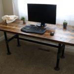 Barnwood desk with heavy-duty black pipe base. Wood reclaimed from a western Wyoming elk feedground's corral trap.
