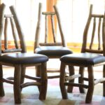 Set of chairs built from hand-collected Ponderosa Pine with upholstered leather seats